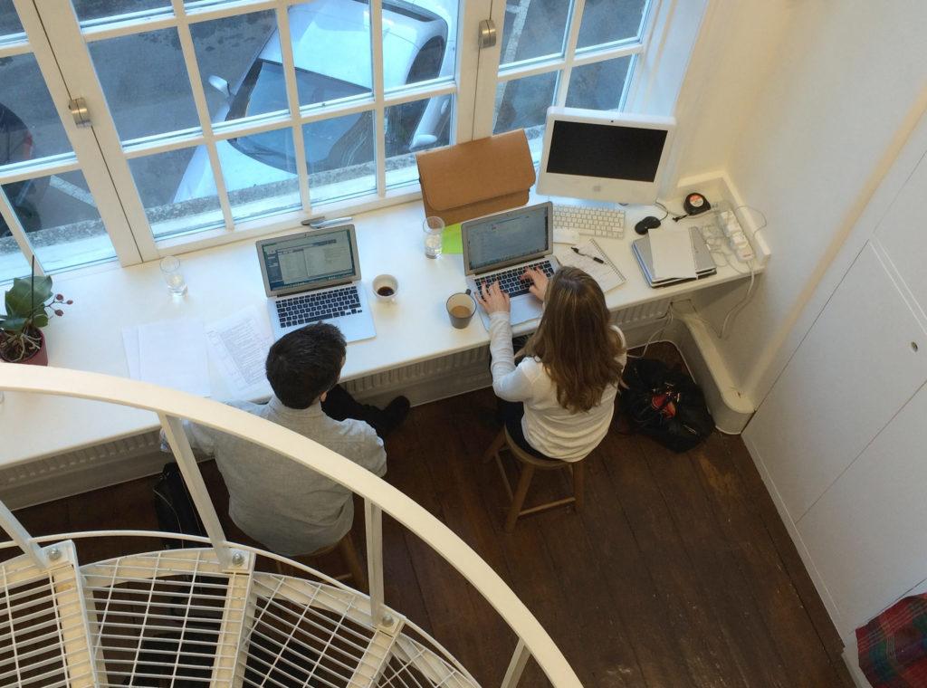 C & J Working by window