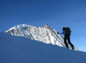 Someone skiing uphill